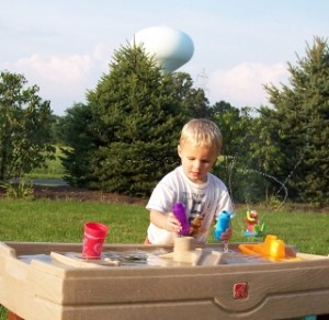 boy_playing_water_small