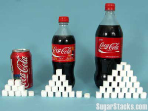 A 12 oz can of Coca-cola has 39 grams of sugar and contains 140 calories, of which 140 calories are from sugar. A 20 oz. bottle has 65 grams of sugar and contains 240 calories, of which 240 calories are from sugar. A 1 liter (33.8 oz.) bottle has 108 grams of sugar and contains 400 calories, of which 400 are from sugar.
