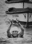 Jack on one of his birthday swims, with handcuffs on